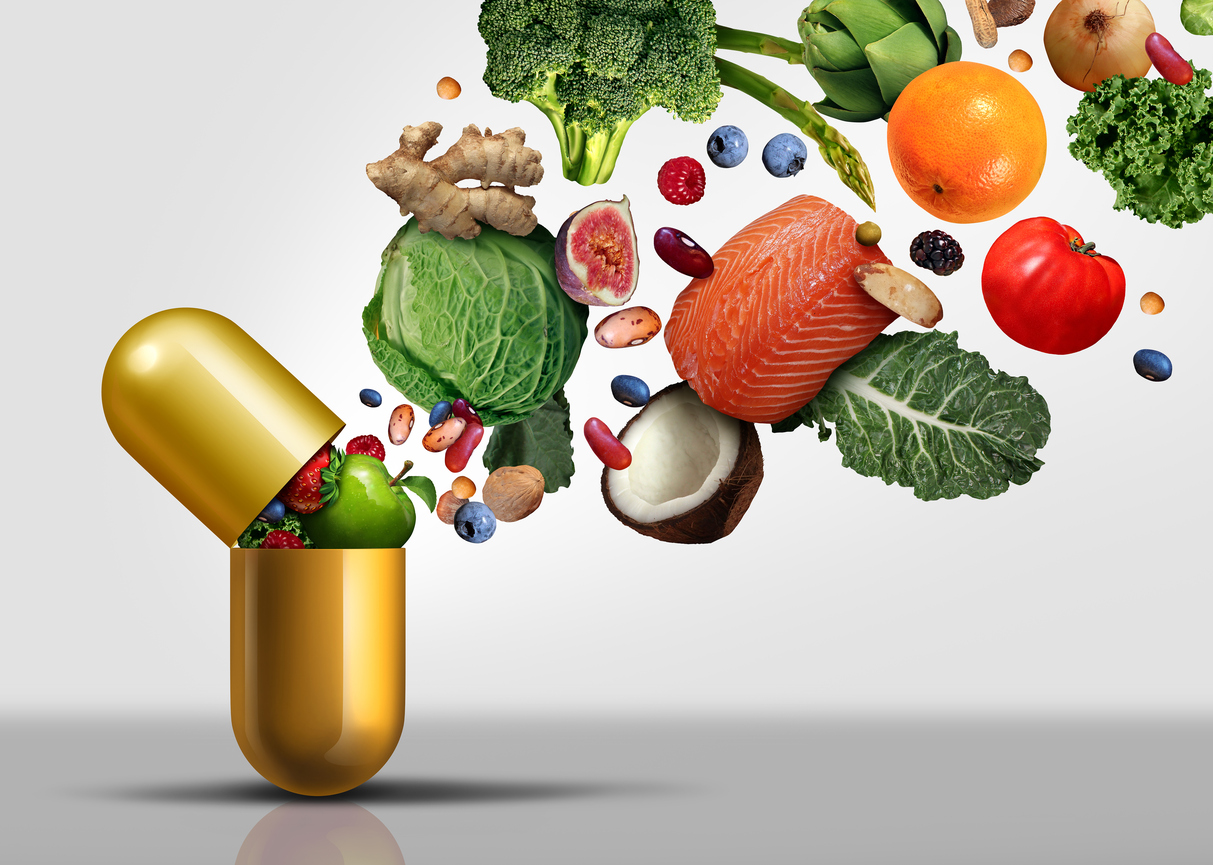 Pill capsule opened up and shooting out nutritional foods such as vegetables and fruits